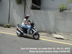 SriLanka tour - Woman on bike